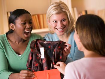 Woman giving a friend a gift