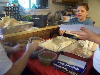 Family making tamales