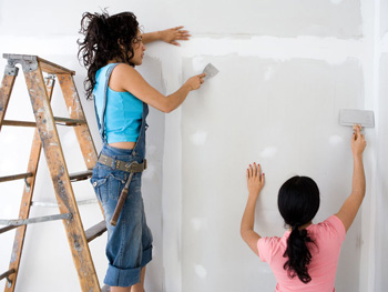 Women painting walls