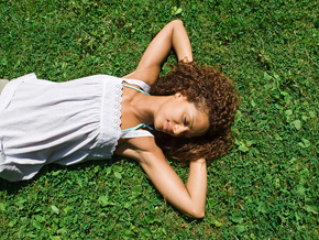 Peaceful woman in grass
