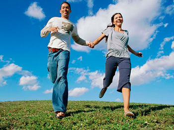 Couple running holding hands