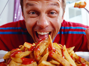 Man eating french fries
