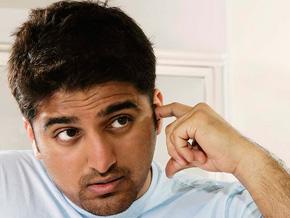 Man picking his ear