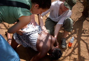 Seane Corn aiding a woman in labor in Uganda