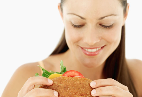 Happy woman eating