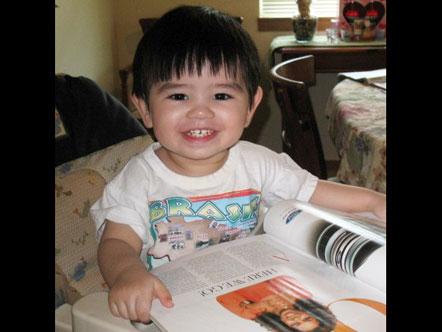 Tristan reading <i>O</i> magazine