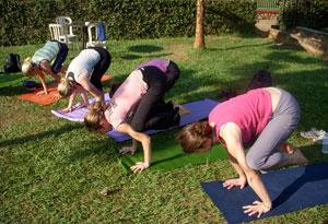 Seane Corn practicing yoga.