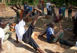 Seane Corn practicing yoga in Uganda.
