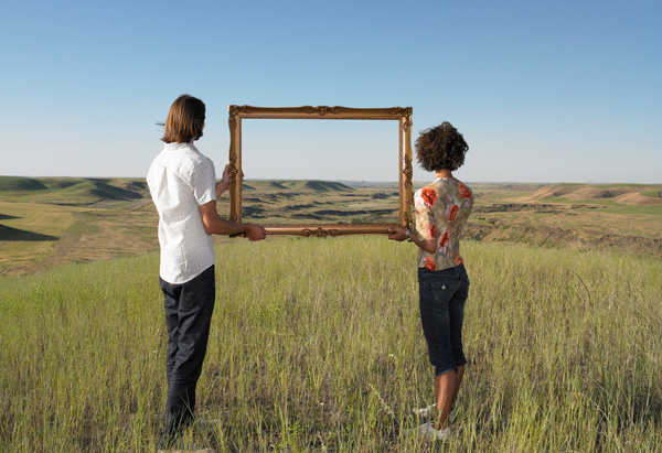 Couple holding a picture frame