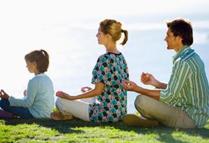 Family meditating together