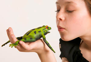 Girl kissing frog prince