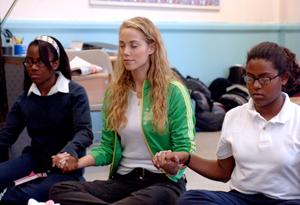 Elizabeth Berkley and young women meditating