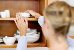 Woman organizing dishes