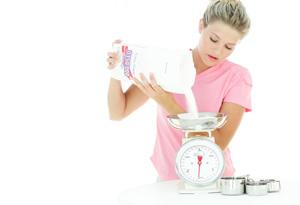 Woman weighing sugar