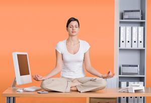 Woman meditating at work