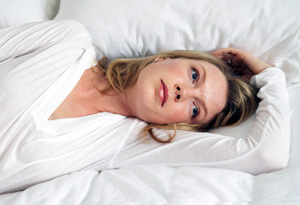 Woman thinking in bed