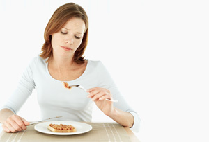 Woman questioning what she's eating