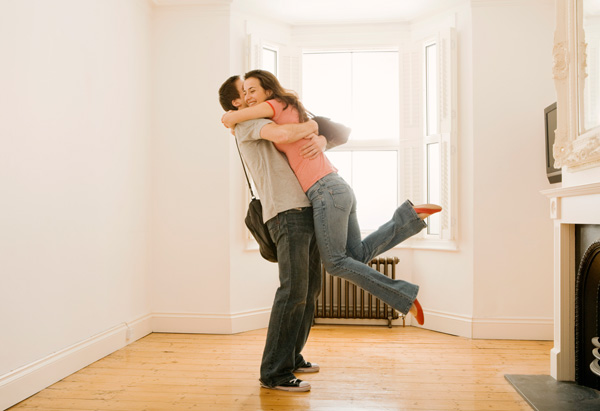 Couple hugging in house