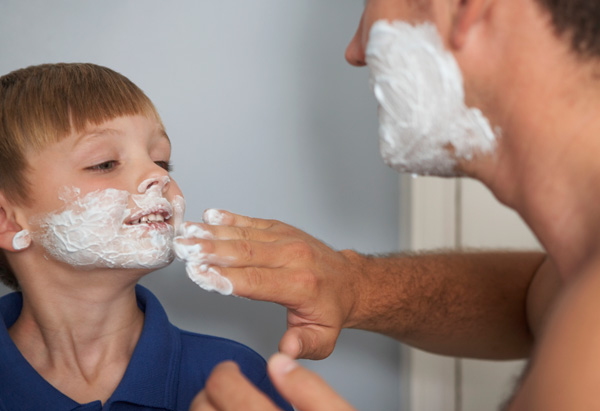 Dad and son shave