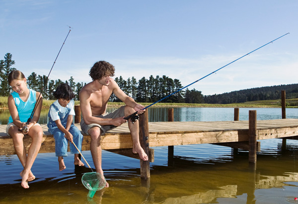 Dad and kids fishing