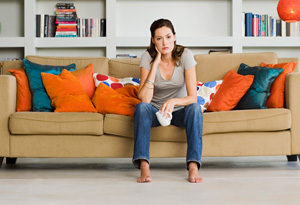 Bored woman on sofa