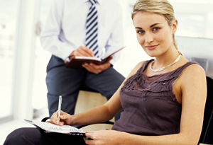 Businesswoman writing in journal