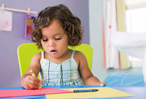 Young girl coloring alone