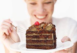 Woman eating chocolate cake