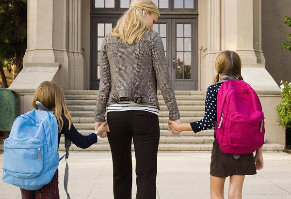 Mom walking kids to school