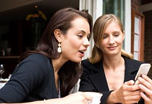 People talking, looking at phone