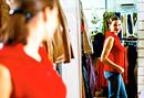 Woman looking in mirror.