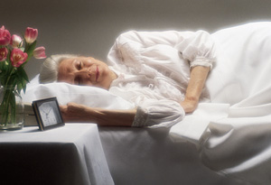 Older woman in bed