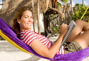 Woman in hammock writing in journal