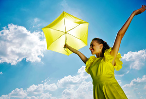 Happy woman with yellow umbrella