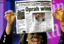Oprah Winfrey holding newspaper