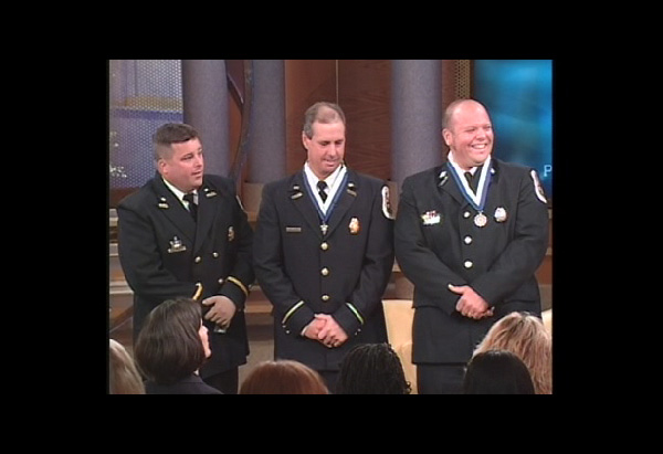 Phil Bird and Kenny Ward receive Medal of Valor for saving fellow firefighter.
