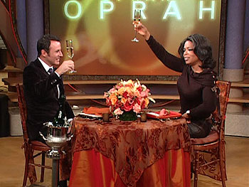 Oprah and Colin Cowie toast the newlyweds
