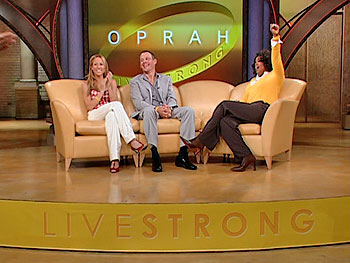 Oprah, Lance Armstrong and Sheryl Crow wear LIVESTRONG wristbands.
