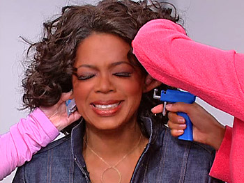 Oprah gets her ear pierced