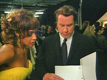 Gayle King and John Travolta