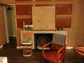 Nate Berkus added leather with baseball stitching to the wood paneling in his library.