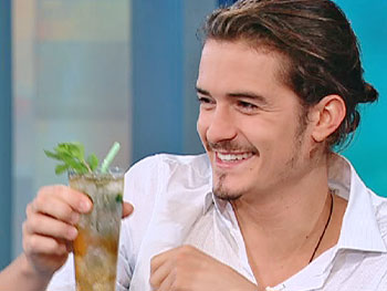 Orlando Bloom enjoys a mint julep.