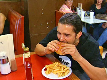 Orlando Bloom chows down on a Wagner burger.