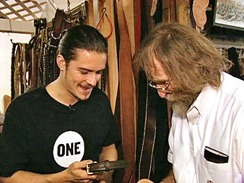 Orlando Bloom picks out collars for Oprah's puppies.