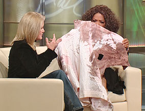 Oprah holds Mary Jo's blood-soaked jacket