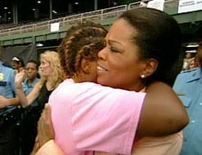 Oprah comforts a Katrina survivor.