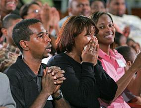 Katrina survivors get the big news from Oprah.