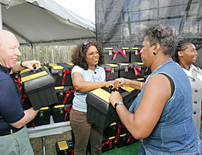 Houston's mayor, Bill White, and Oprah pass out Habitat toolboxes