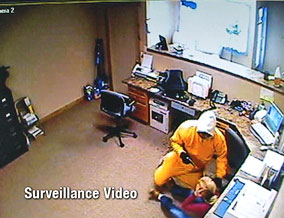 Surveillance video of Angi being robbed at gunpoint