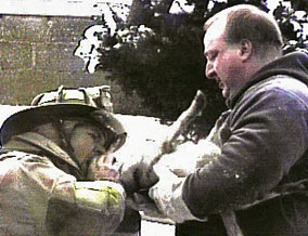 Firemen resuscitating Pixie